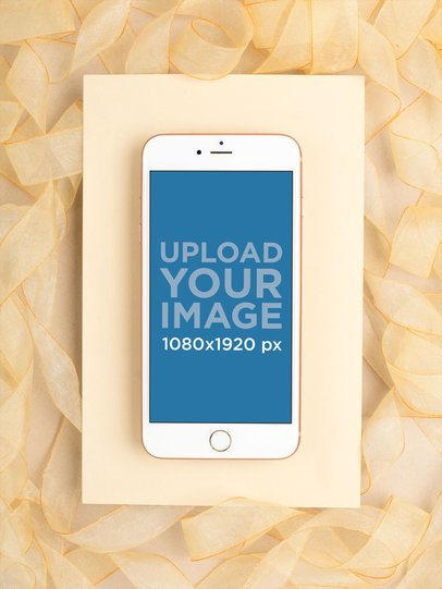 Gold iPhone 8 Mockup Lying on a Surface Decorated with Gold Organza Ribbon 22185