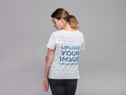 Back Shot T-Shirt Mockup of a Woman with a Low Ponytail and Hoop Earrings 21301