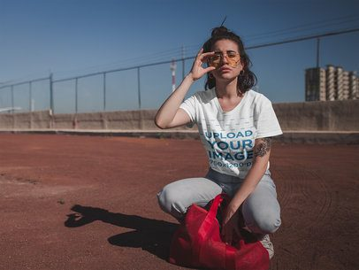 T-Shirt Mockup Featuring a Cool Woman Crouching 20040
