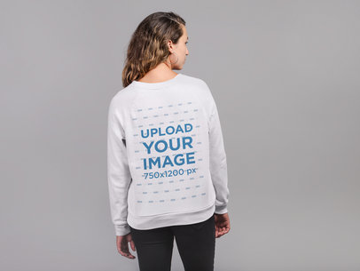 Back View Sweatshirt Mockup Featuring a Woman Against a Gray Wall 21305