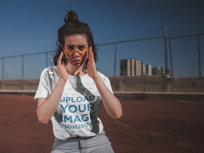 T-Shirt Mockup of a Woman Looking Over Her Glasses 20016