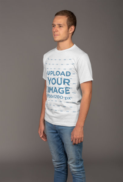 Plain T-Shirt Mockup Featuring a Man in a Studio 21137