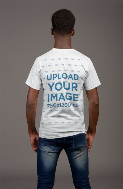 Back View T-Shirt Mockup of a Thin Man Against a Flat Gray Wall 21158