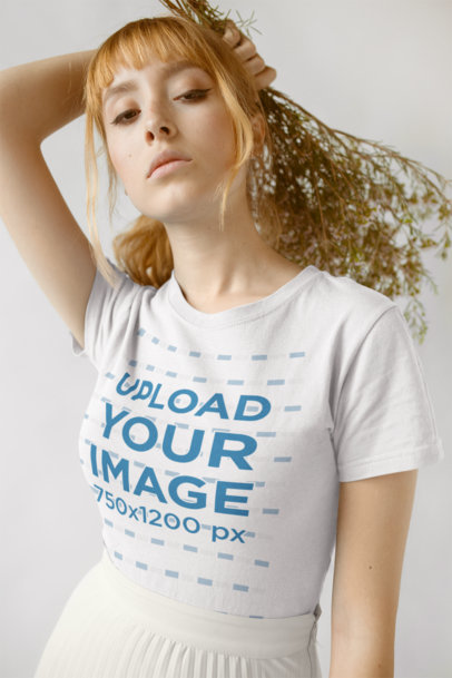 T-Shirt Mockup Featuring a Woman With Her Hair Tied Into a Loose Ponytail 18381