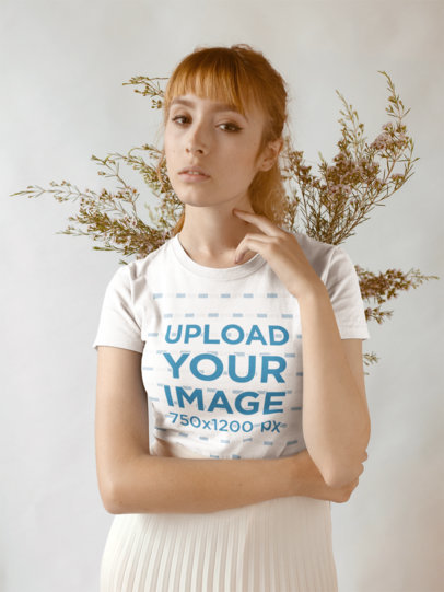 T-Shirt Mockup of a Serious Woman Against Dried Plants 18382