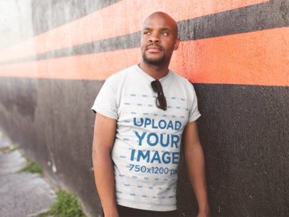 Round Neck Tee Mockup of a Bald Man Leaning Against a Wall 20776