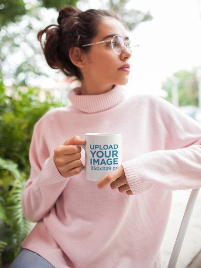 Mockup of a Coffee Mug Held by a Woman Wearing a Turtleneck Sweater 22425