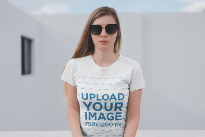 Tshirt Mockup of a Serious Blonde Woman with Blurry Background 19455