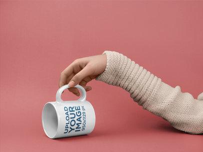 Mockup of a Lazy Arm Touching a Coffee Mug Handle 22374