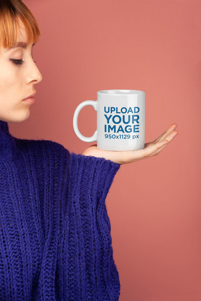 Coffee Mug Mockup Held by a Woman Wearing a Royal Blue Sweater 22417