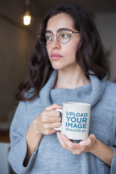 Coffee Mug Mockup Featuring a Girl Wearing a Turtleneck Sweater and Round Glasses 22434