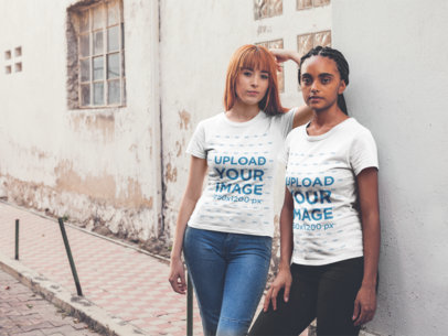 Mockup of Two Women Wearing T-Shirts in Front of a Decaying Wall 20762