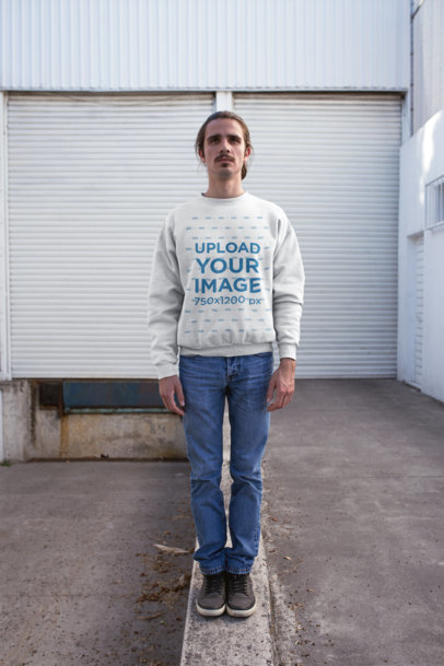 Sweatshirt Mockup of a Man Standing on a Thick Ledge 20308