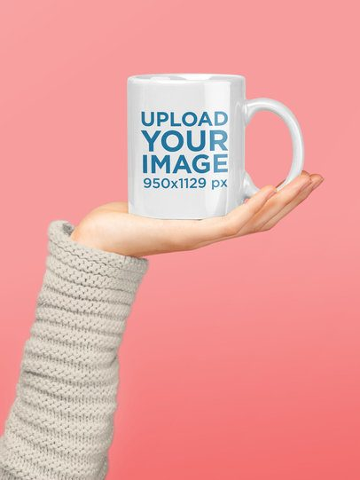 Mug Mockup Held by a Woman Over a Solid Backdrop 22418