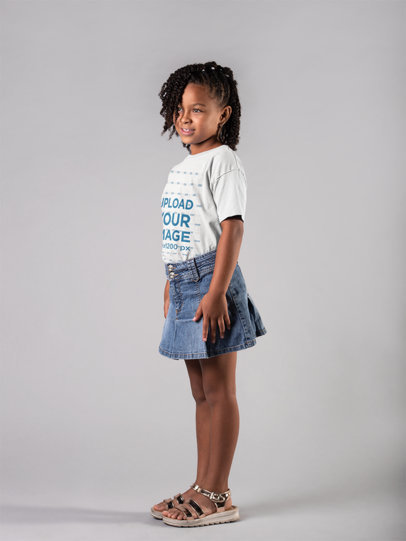 Mockup Featuring a Smiling Little Girl Wearing a T-Shirt and a Denim Skirt  22032