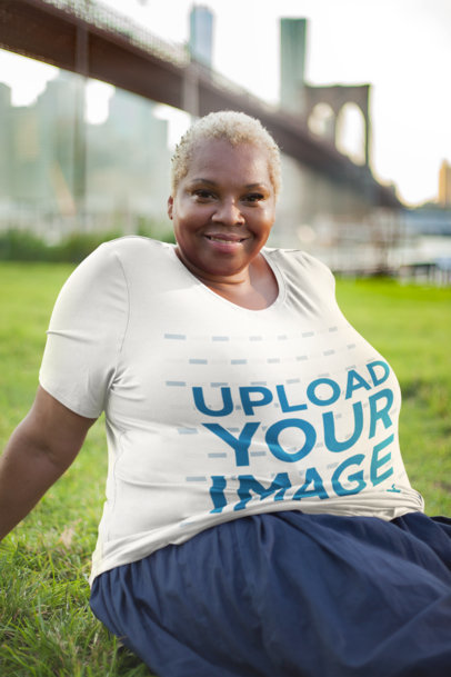 Plus Size T-Shirt Mockup Featuring a Woman Near the Brooklyn Bridge 22566