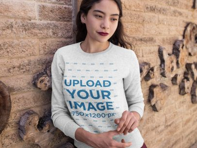 Crewneck Sweatshirt Mockup of a Woman Leaning on a Textured Wall 18138