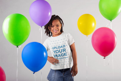 T Shirt Mockup Featuring a Happy Little Girl Between Party Balloons 22041