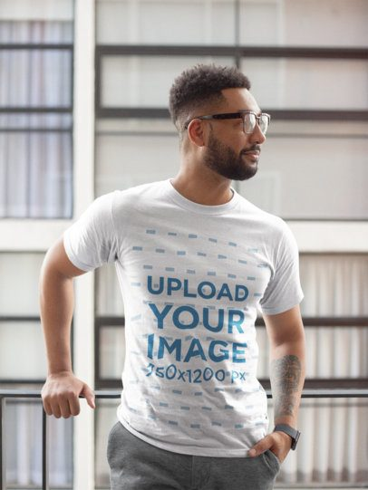 T-Shirt Mockup of a Man With a Hand in His Pocket and Looking to One Side 21342