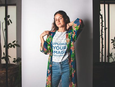 T-Shirt Mockup of a Girl at a Photo Studio with Plants 18451