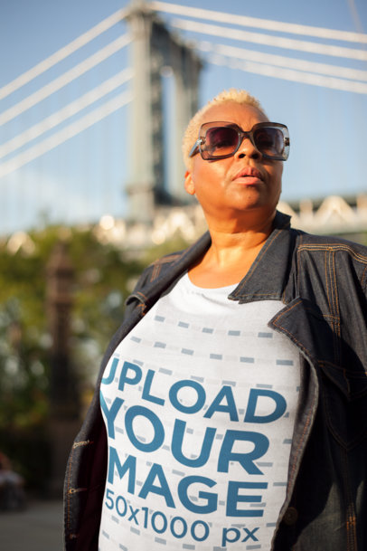 Mockup of a Woman Wearing a Plus Size T-Shirt in New York City 22572