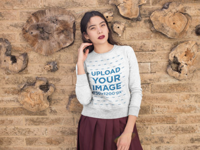 Sweatshirt Mockup of a Woman Standing in Front of a Textured Wall 18150