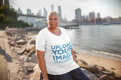 Plus Size T-Shirt Mockup of a Woman in Front of the NYC Skyline 22561
