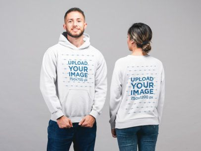Back View of a Sweatshirt and Front View of a Hoodie Mockup of a Man and a Woman at a Studio 22357