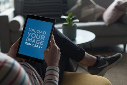 iPad Mockup Held in A Living Room Setting 22619