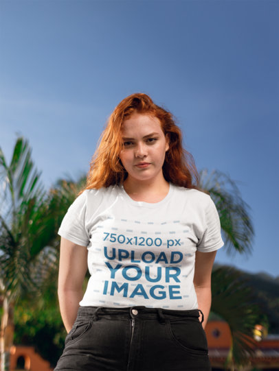 Mockup of a Woman Wearing a T-Shirt with Palm Trees Behind Her 21936
