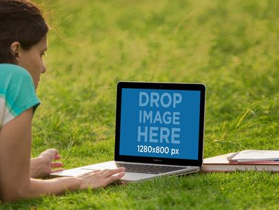Laptop Mockup of a Girl Working on her Macbook at the Park a2416