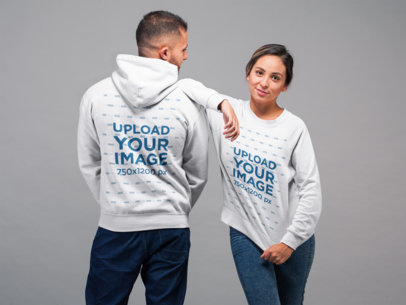 Both Sides Mockup of a Man Wearing a Pullover Hoodie and a Woman Wearing a Sweatshirt 22356