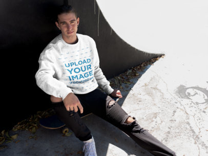 Sweatshirt Mockup Featuring a Cool Man Sitting on His Skateboard 18164