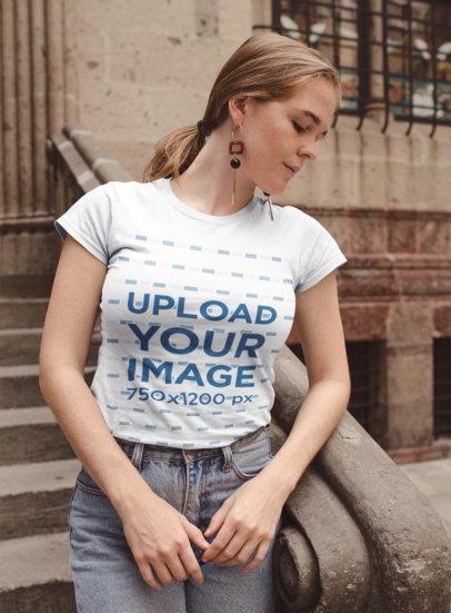 Tshirt Mockup Featuring a Girl Standing at a Stone Church Entrance 22651