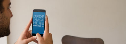 Android Mockup Featuring a Young Man Using a Samsung Galaxy a2872