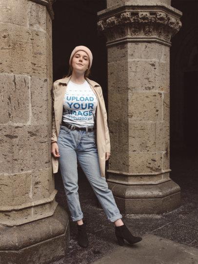 T-Shirt Mockup Featuring a Woman Outside a Stone Church 22653