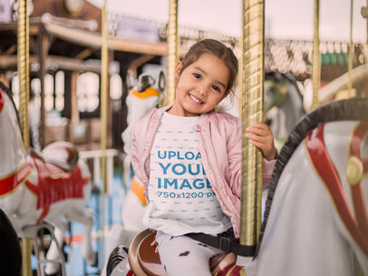T-Shirt Mockup of a Smiling Little Girl on a Carousel Horse 22528