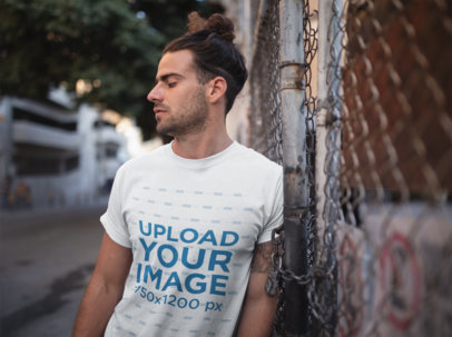 T-Shirt Mockup of a Man with a Man Bun Fade Hairstyle 19945