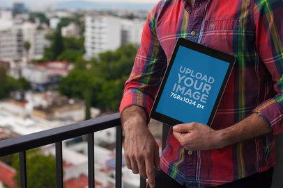 iPad Mockup Held by a Man Wearing a Checkered Shirt 22617