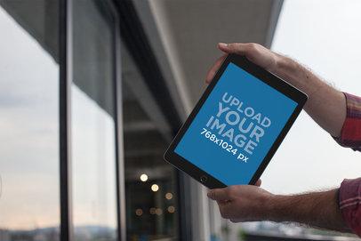 Mockup of an iPad Held on a Balcony 22618