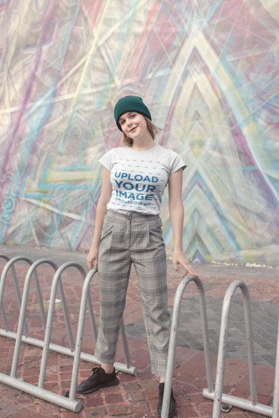 T-Shirt Mockup Featuring a Woman in Front of Street Art 22670