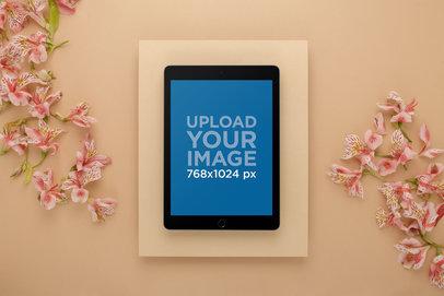 Mockup of an iPad on a Studio Set with Lilies 22700