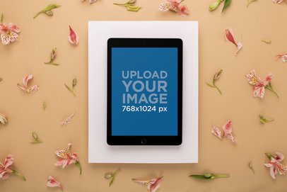 iPad Mockup on a White Floating Paper Over a Tan Surface with Lilies 22701
