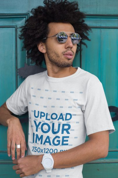 Mockup of a Man with an Afro Wearing a T-shirt a Ring and a Watch 22253