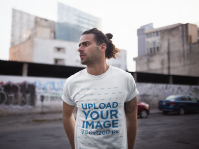 Tshirt Mockup Featuring a Long-Haired Man Downtown 19947