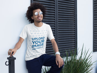 Mockup of a Smiling Man Wearing a Crew Neck Tshirt Outside his House 22255