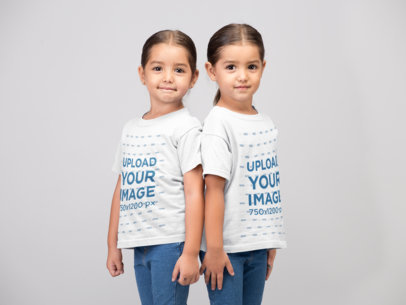 Mockup Twin Girls Wearing T-Shirts Standing Against Each Other's Back 22517