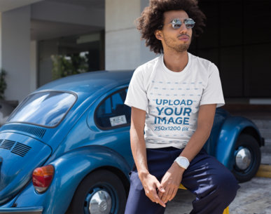 T-Shirt Mockup of a Man with an Afro Leaning on a Parking Rail 22258