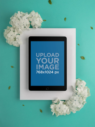 Space Gray iPad Mockup on Cardboard Paper with White Flowers 22710