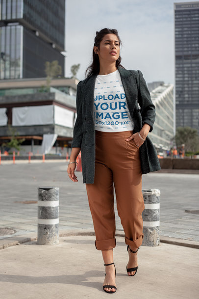 Round Neck Tee Mockup of a Girl Walking by a Financial Center 22685